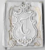 6 Monogrammen J.E. 4,5 x 2,5 cm