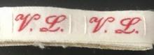 1 Initiaal - Lint V.L. Lint 1 cm breed